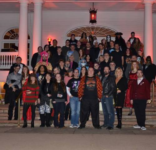 Group photo of the retreat attendees. RJ Cavender is in the center wearing a sweater (a gift from Rena Mason) that has the same pattern as the carpet in the film THE SHINING.